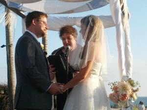 Me officiating at a wedding for a beautiful couple in a gorgeous setting.